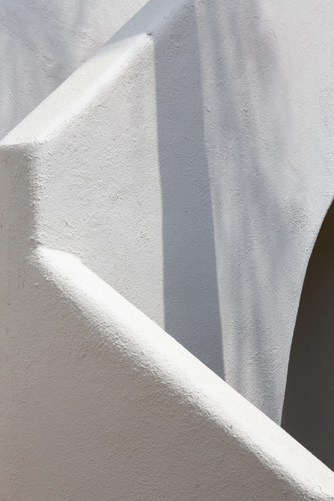 A photograph by the artist of a white plaster exterior staircase